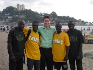 Will Smith '14 on the beaches of Monrovia with four Liberian research assistants in July 2013 who helped him implement a field experiment to assess the impact of solar lights among fishermen.